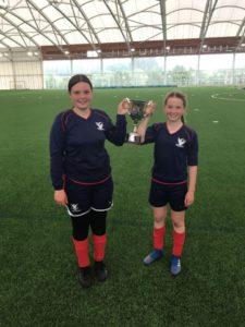 U13s Girls celebrating win lifting national cup