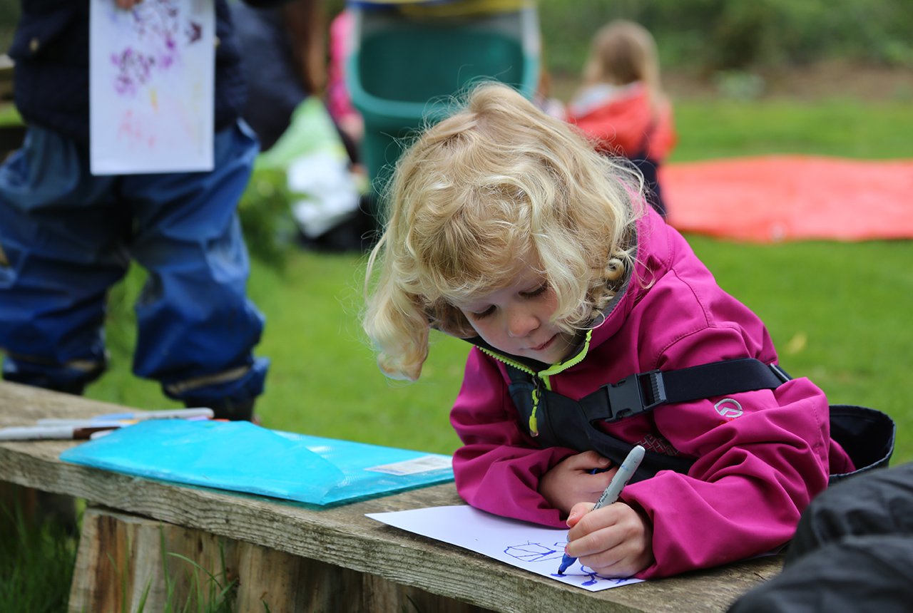 Colouring outside at the Stamford Nursery School