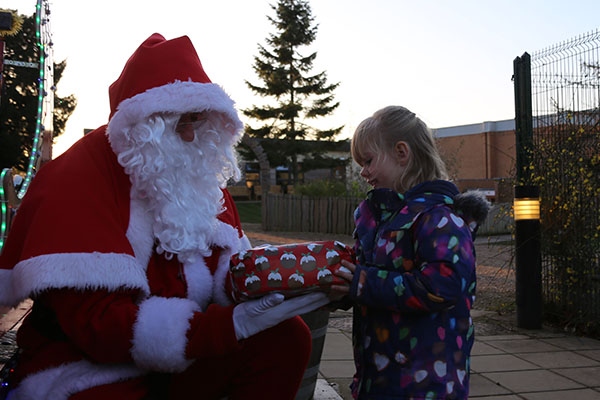 Santa visits the Stamford Nursery School to receive donated gifts