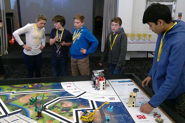 Discussing tatics at the Lego League competition