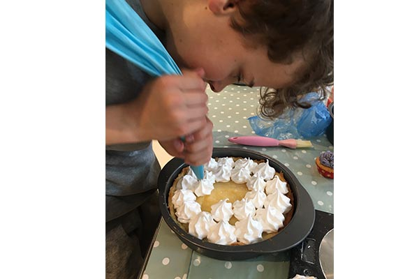Matthew celebrates progress in Junior Bake-Off